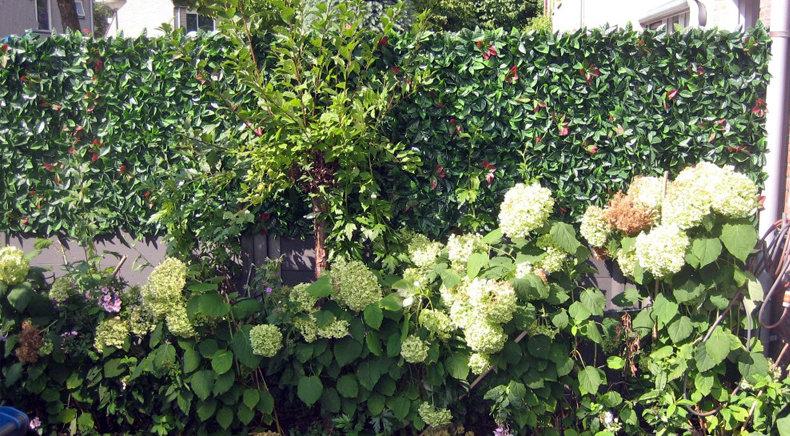 Tuinscherm verhoging met kunsthaag